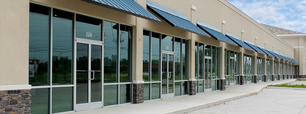 a picture of a line of empty strip mall offices
