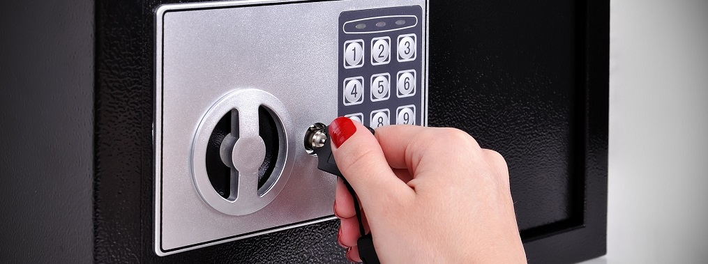 a woman's hand tuning a safe key